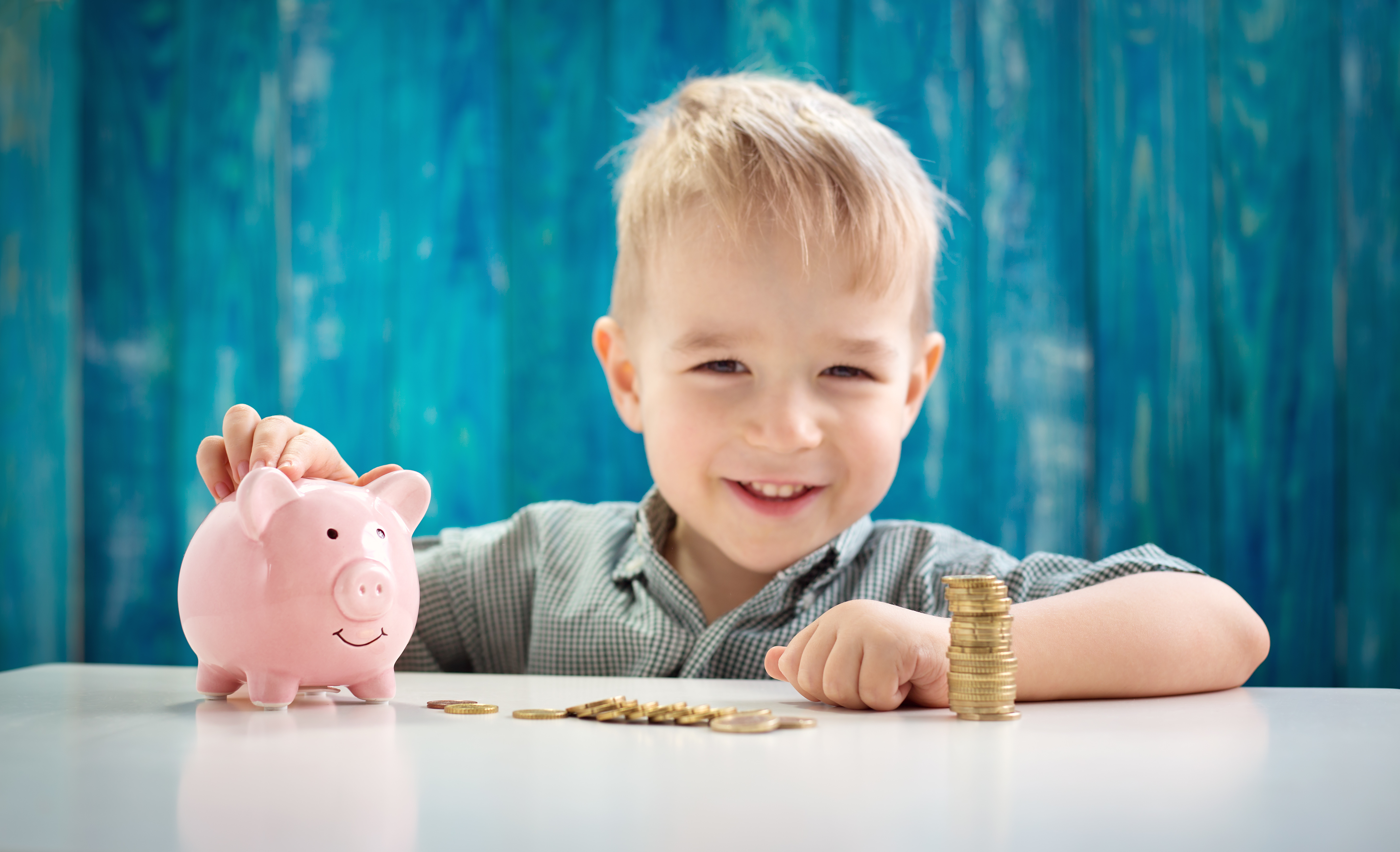 Boy with piggy bank and coins