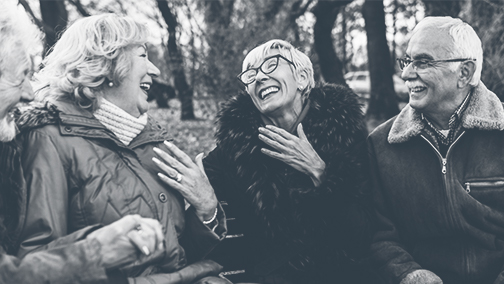 Two older couples laughing